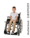 Boy In Wheelchair On White...