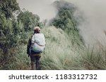 cute girl hiking adventure on... | Shutterstock . vector #1183312732
