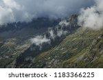 mountain peaks in the clouds in ... | Shutterstock . vector #1183366225