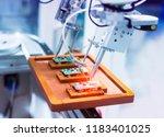 soldering iron tips of robotic... | Shutterstock . vector #1183401025