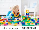 child playing with colorful toy ... | Shutterstock . vector #1183406098