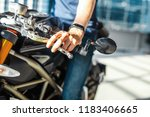 close up of biker holding hand... | Shutterstock . vector #1183406665