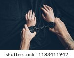 partial view of man holding... | Shutterstock . vector #1183411942