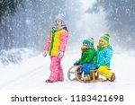 little girl and boy enjoying... | Shutterstock . vector #1183421698
