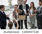 young employee meets with the... | Shutterstock . vector #1183447138