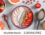 acai smoothie bowl with... | Shutterstock . vector #1183461982