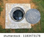 a hole of grease trap... | Shutterstock . vector #1183473178