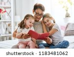 grandmother reading a book to... | Shutterstock . vector #1183481062