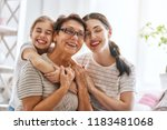 a nice girl  her mother and... | Shutterstock . vector #1183481068