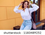 brunette  happy woman with... | Shutterstock . vector #1183489252