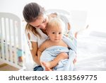 young mom  playing with her... | Shutterstock . vector #1183569775