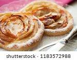 apple tartlets  puff pastry.... | Shutterstock . vector #1183572988