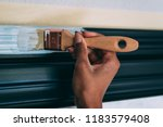 woman hands painting with a... | Shutterstock . vector #1183579408