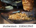sliced meat under a vertical... | Shutterstock . vector #1183613965