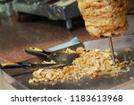 sliced meat under a vertical... | Shutterstock . vector #1183613968