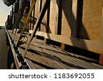 a load of cargo strapped to the ... | Shutterstock . vector #1183692055