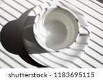 white coffee cup with striped... | Shutterstock . vector #1183695115