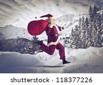 Santa Claus Running On The Sno...
