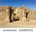 Two Pharaoh Statues Amongst...