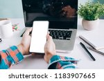 business concept.man holding a...   Shutterstock . vector #1183907665