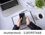 hands using smartphone at...   Shutterstock . vector #1183907668