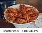 cooked crayfish in a white bowl | Shutterstock . vector #1183933192