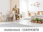 armchair next to wooden table... | Shutterstock . vector #1183943878
