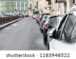 a number of cars parked in a... | Shutterstock . vector #1183948522