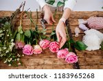 florist makes a bouquet. | Shutterstock . vector #1183965268