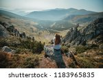 young girl enjoying a view from ... | Shutterstock . vector #1183965835