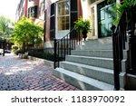 street and row of brownstones... | Shutterstock . vector #1183970092