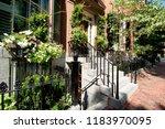 street and row of brownstones... | Shutterstock . vector #1183970095