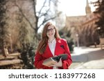 student smiling with notebook... | Shutterstock . vector #1183977268