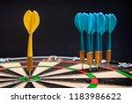 close up view of a yellow dart... | Shutterstock . vector #1183986622