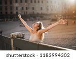 woman with open arms feeling... | Shutterstock . vector #1183994302