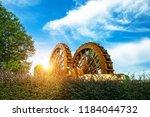 a spinning waterwheel | Shutterstock . vector #1184044732