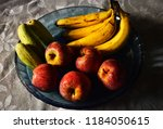 fruits displayed in a bowl on a ... | Shutterstock . vector #1184050615