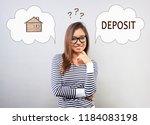 happy smiling doubt latina... | Shutterstock . vector #1184083198