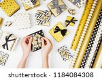 female hands tying a bow.... | Shutterstock . vector #1184084308