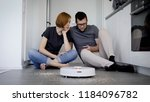 man and woman are sitting on a... | Shutterstock . vector #1184096782