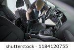 bending faceless worker in... | Shutterstock . vector #1184120755