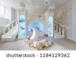 interior of a spacious children'... | Shutterstock . vector #1184129362