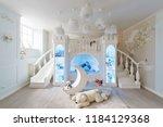 interior of a spacious children'... | Shutterstock . vector #1184129368