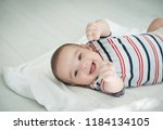 baby laugh at home | Shutterstock . vector #1184134105