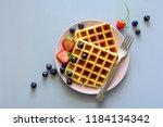 belgian waffles with... | Shutterstock . vector #1184134342