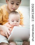 little boy and baby brother on... | Shutterstock . vector #1184138302