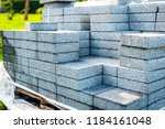 stack of concrete paving slabs... | Shutterstock . vector #1184161048