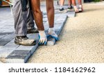 laying gray concrete paving... | Shutterstock . vector #1184162962