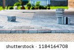 laying gray concrete paving... | Shutterstock . vector #1184164708