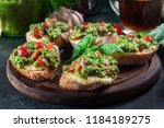 bruschetta with fresh pesto ... | Shutterstock . vector #1184189275